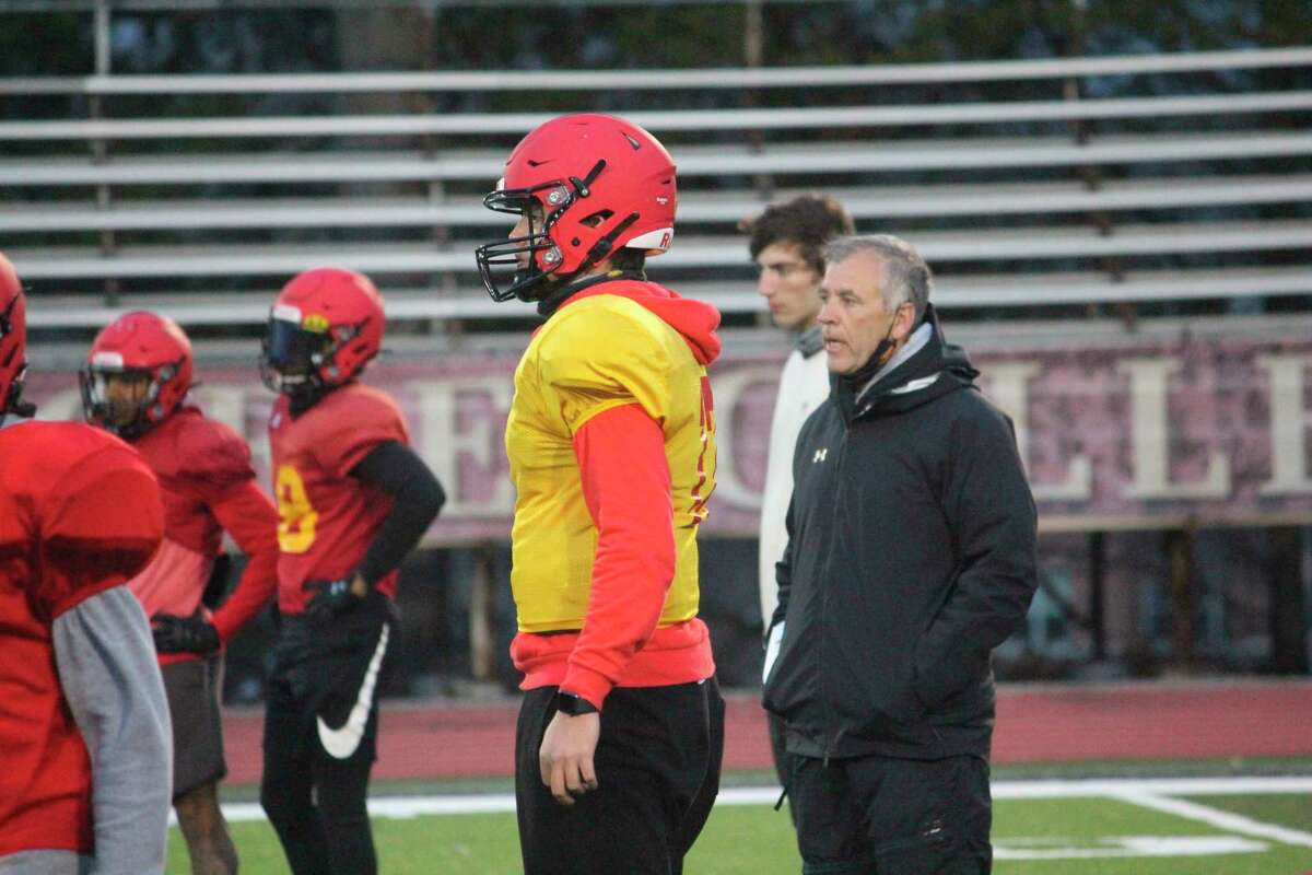 Ferris football coach Tony Annese (right) watches the action during a practice at Top Taggart Field. (Pioneer photo/John Raffel)