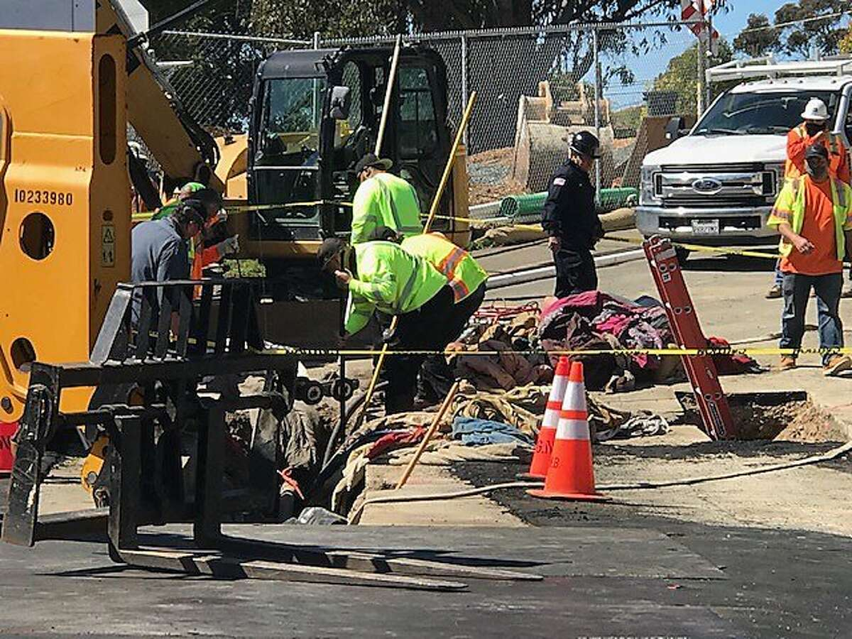 Workers rescuing people living in a 20-foot-long cave discovered under a Vallejo bridge on Friday, March 26 2021.