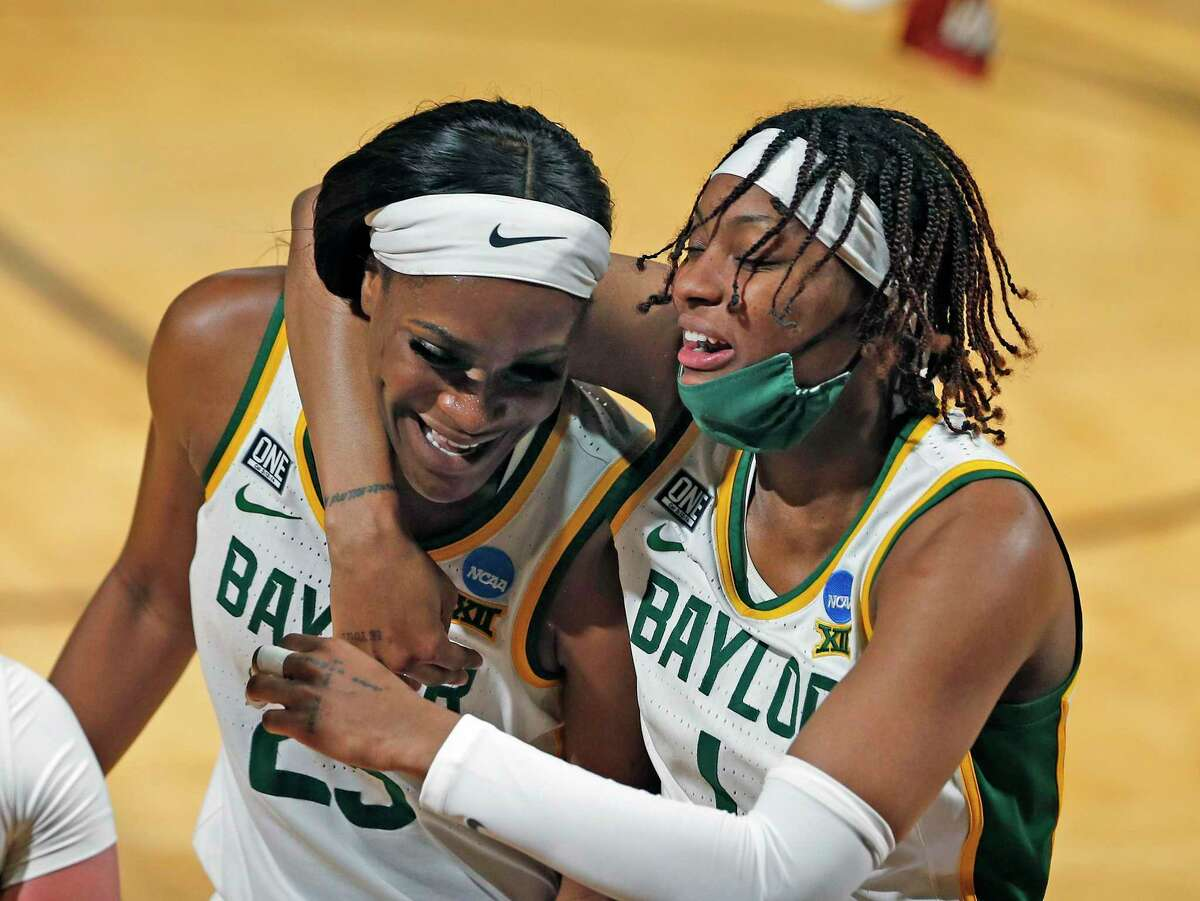 Baylor forward NaLyssa Smith (1) celebrates with teammate Baylor center Queen Egbo (25) at the end of the first half of a college basketball game in the second round of the women's NCAA tournament at the Greehey Arena in San Antonio, Tuesday, March 23, 2021. (AP Photo/Ronald Cortes)