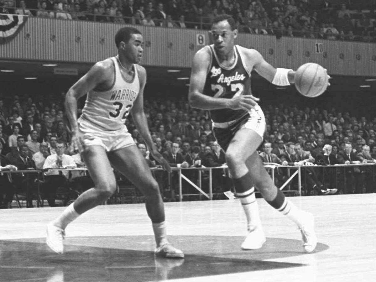 Elgin Baylor (22) of the Los Angeles Lakers makes a fast break past San Francisco Warriors' McCoy McLemore (32) during the season opening game at San Francisco Civic Auditorium in October 1965. Baylor served a 6-month tour of duty in 1959, including time at Fort Sam Houston in San Antonio playing for the Brooke Army Medical Center Comets.