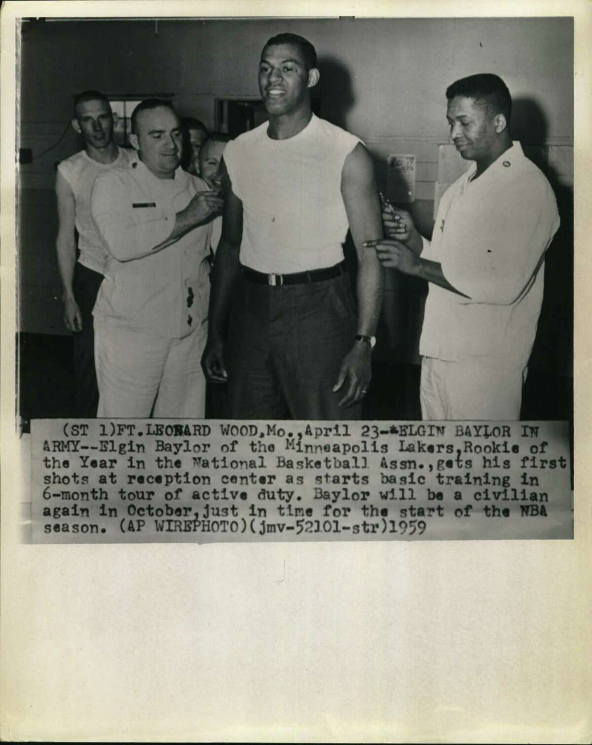 Elgin Baylor of the then-Minneapolis Lakers, the National Basketball Association's Rookie of the Year, gets his first vaccinations April 23, 1959, at Fort Leonard Wood, Mo. In July and August, he was in San Antonio at Fort Sam Houston to train as a medical corpsman during a 6-month tour of active duty. He became a civilian again in October, just in time for the start of the NBA season.