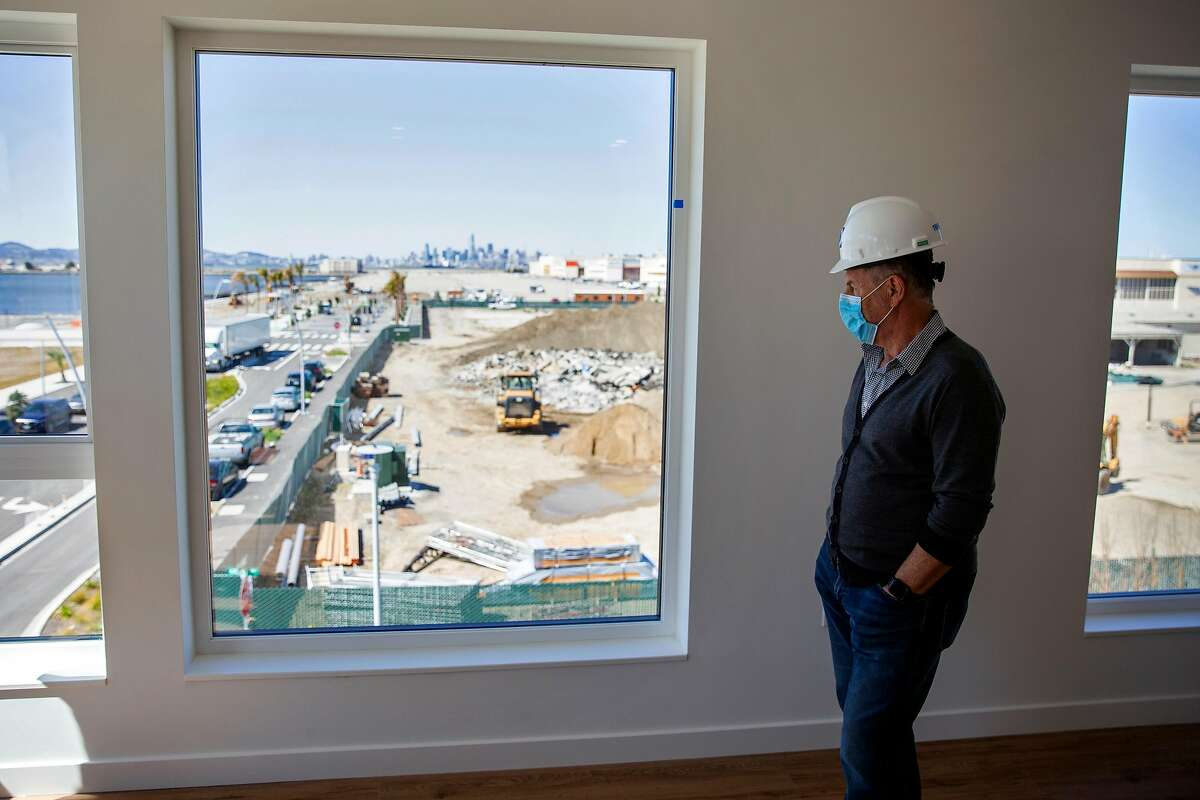 Bruce Fairty, Chief Operating Officer of Cypress Equity Investments, looks out the window of a finished unit at AERO Apartments at Alameda Point in Alameda, Calif. on Tuesday, March 23, 2021