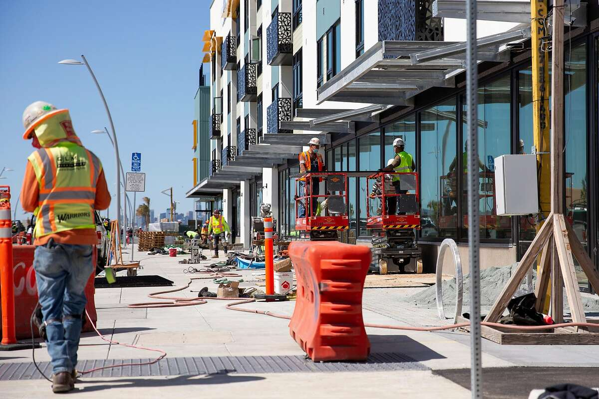 Construction crews work on the AERO Apartments building at Alameda Point in Alameda, Calif. on Tuesday, March 23, 2021