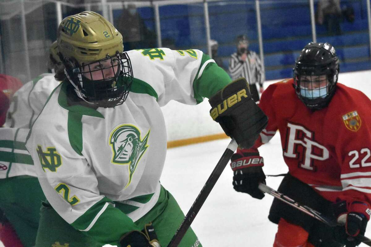 Notre Dame-West Haven's Ty Battipaglia looks for an open teammate against Fairfield Prep during a game at Bennett Rink in West Haven on March 10.