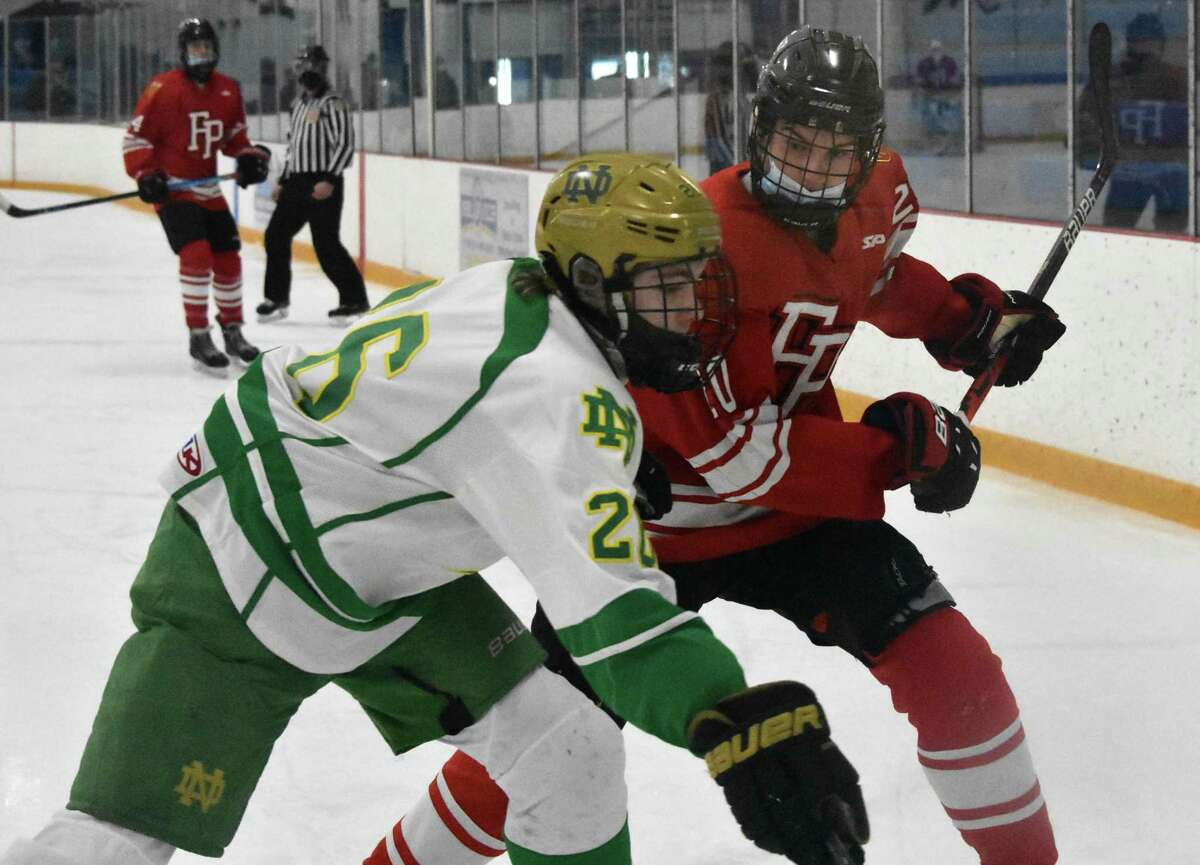 Fairfield Prep's Tiernan Curley lines up to hit Notre Dame-West Haven's Zach Schroeder during a game at Bennett Rink in West Haven on March 10.