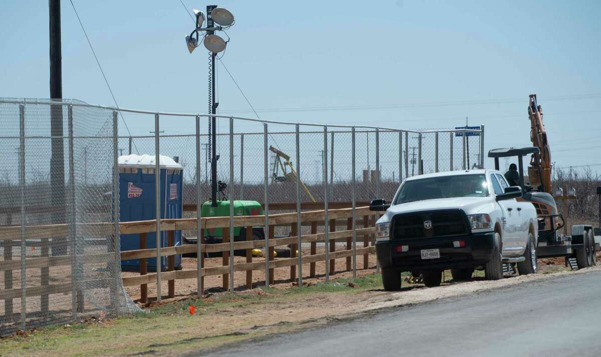 New tall fencing is being installed 03/26/21 at Cotton Logistics Man Camp off CR 150 and FM 1788 for the migrant children housed in the facility. Tim Fischer/Reporter-Telegram