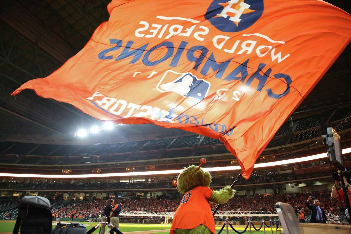 While the Astros were celebrating their 2017 championship clincher at Dodger Stadium in Los Angeles, team mascot Orbit joined a gathering of frenzied fans at Minute Maid Park.
