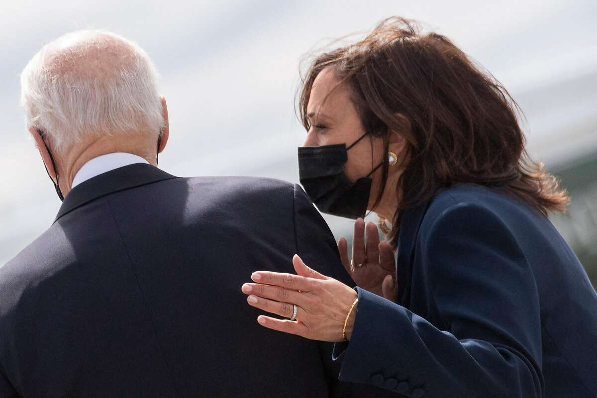 US President Joe Biden (R) and US Vice President Kamala Harris arrive at Dobbins Air Reserve Base in Marietta, Georgia, on March 19, 2021. Biden and Harris travel to Atlanta, Georgia, to tour the Centers for Disease Control and Prevention, and to meet with Georgia Asian American leaders, following the Atlanta Spa shootings. (ERIC BARADAT/AFP via Getty Images/TNS)