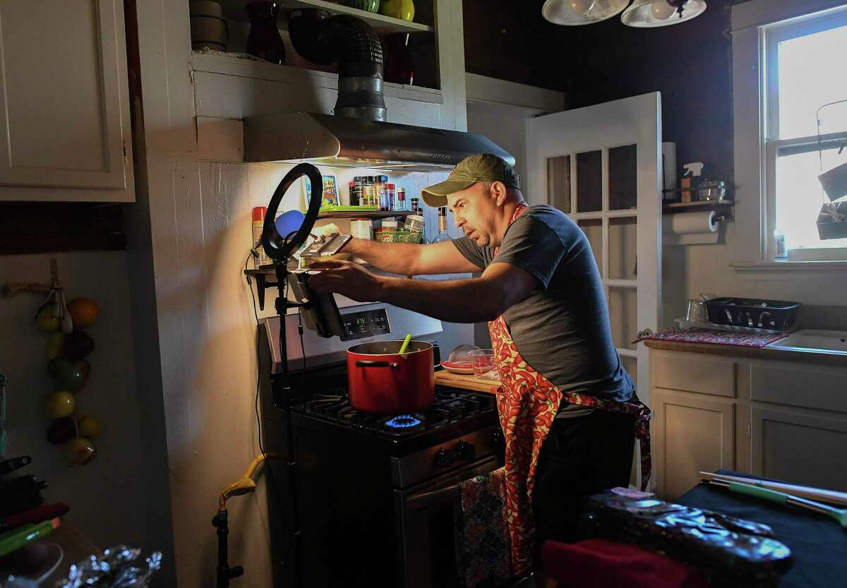 Tarraza's striped-down kitchen studio where he films his Foodie Classroom segments, is a shoestring operation, consisting only of nothing a laptop computer, an iPad with its camera aimed at him, an iPhone shooting down at the pot on the stove and a third camera for a wide-angle view. A single ring light illuminates him and his work area.