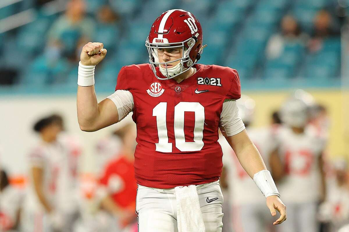 MIAMI GARDENS, FLORIDA - JANUARY 11: Mac Jones #10 of the Alabama Crimson Tide reacts to a touchdown during the second quarter of the College Football Playoff National Championship game against the Ohio State Buckeyes at Hard Rock Stadium on January 11, 2021 in Miami Gardens, Florida. (Photo by Kevin C. Cox/Getty Images)