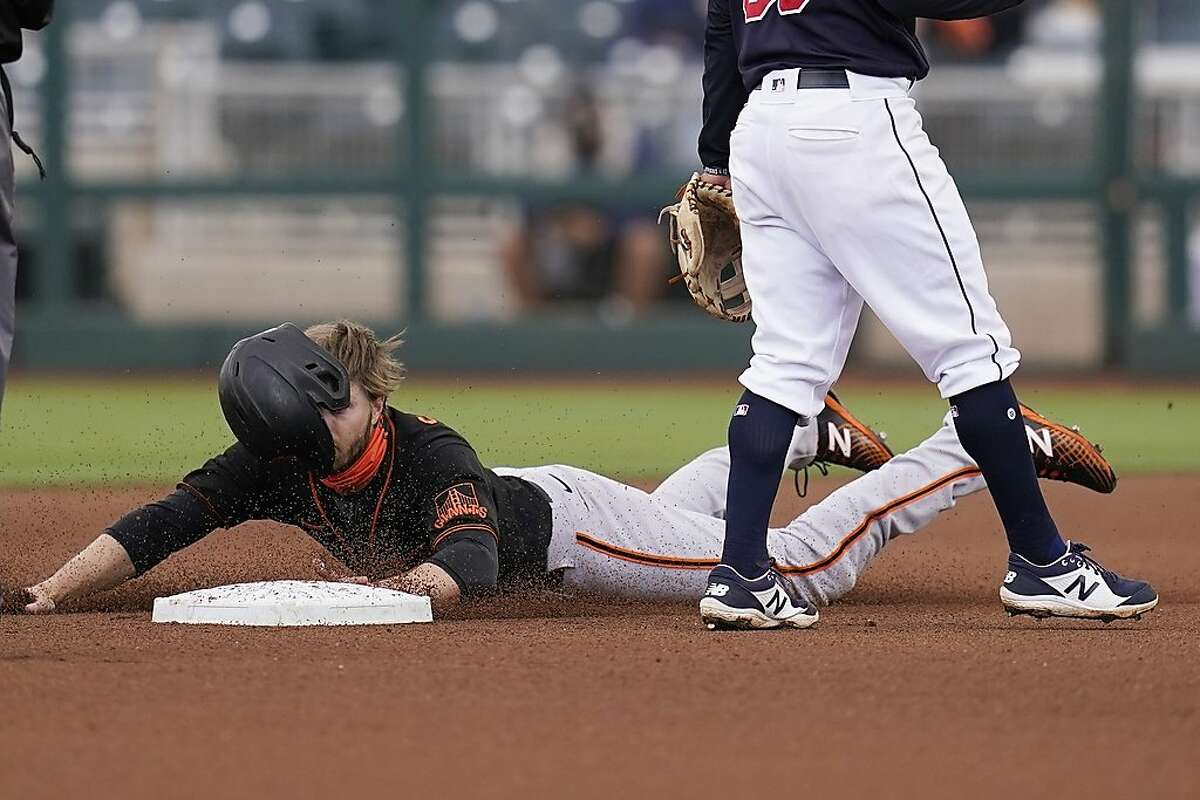 Austin Slater steals second base Tuesday against the Indians in Goodyear, Ariz. Spring offers a chance for many to experiment.