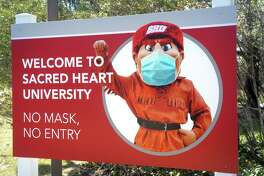 A sign at the entrance to Sacred Heart University's west campus, in Fairfield, Conn. March 10, 2021.