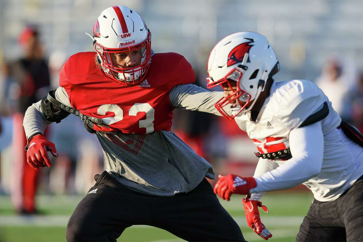 UIW defensive back Moses Reynolds, left, covers a receiver during a morning practice at Gayle and Tom Benson Stadium on Tuesday, Feb. 23, 2021. UIW plays its first game of the spring Southland Conference season Saturday at McNeese State.