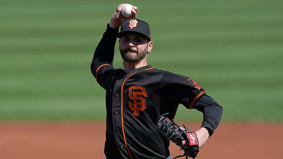 San Francisco Giants starting pitcher Nick Tropeano throws during the first inning of a spring training baseball game against the Chicago Cubs Wednesday, March 10, 2021, in Scottsdale, Ariz. (AP Photo/Ashley Landis)