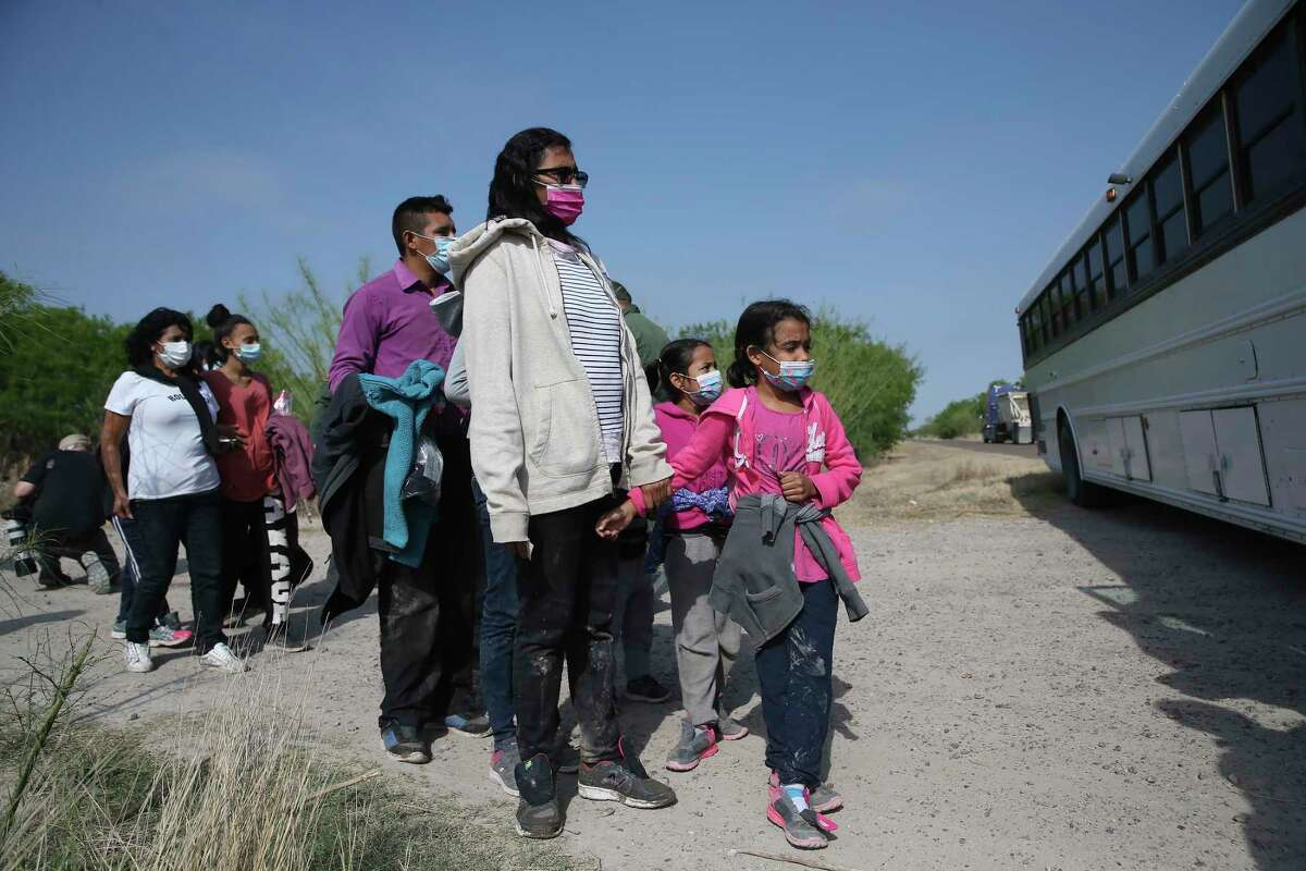 Migrant families are loaded into a bus after they were detained by U.S. Border agents near La Joya, Texas, Friday, March 26, 2021. The group consisted of mostly Central American migrants. In the afternoon, a group 17 Republican U.S. senators visited the area for a tour of the Rio Grande by Anzalduas Park in Mission.