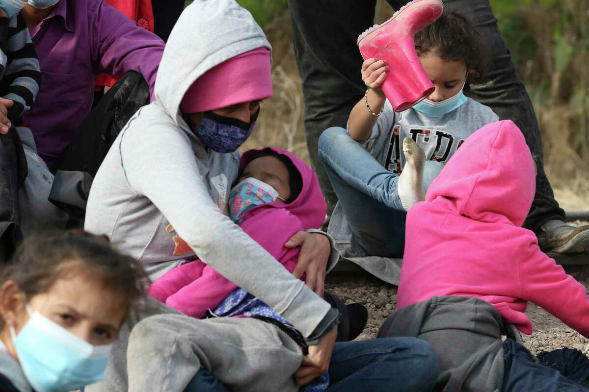 Migrant families are detained by U.S. Border Patrol agents by La Joya, Texas, Friday, March 26, 2021. The group consisted of mostly Central American migrants. In the afternoon, a group 17 Republican U.S. Senators visited the area for a tour of the Rio Grande by Anzalduas Park in Mission, Texas.