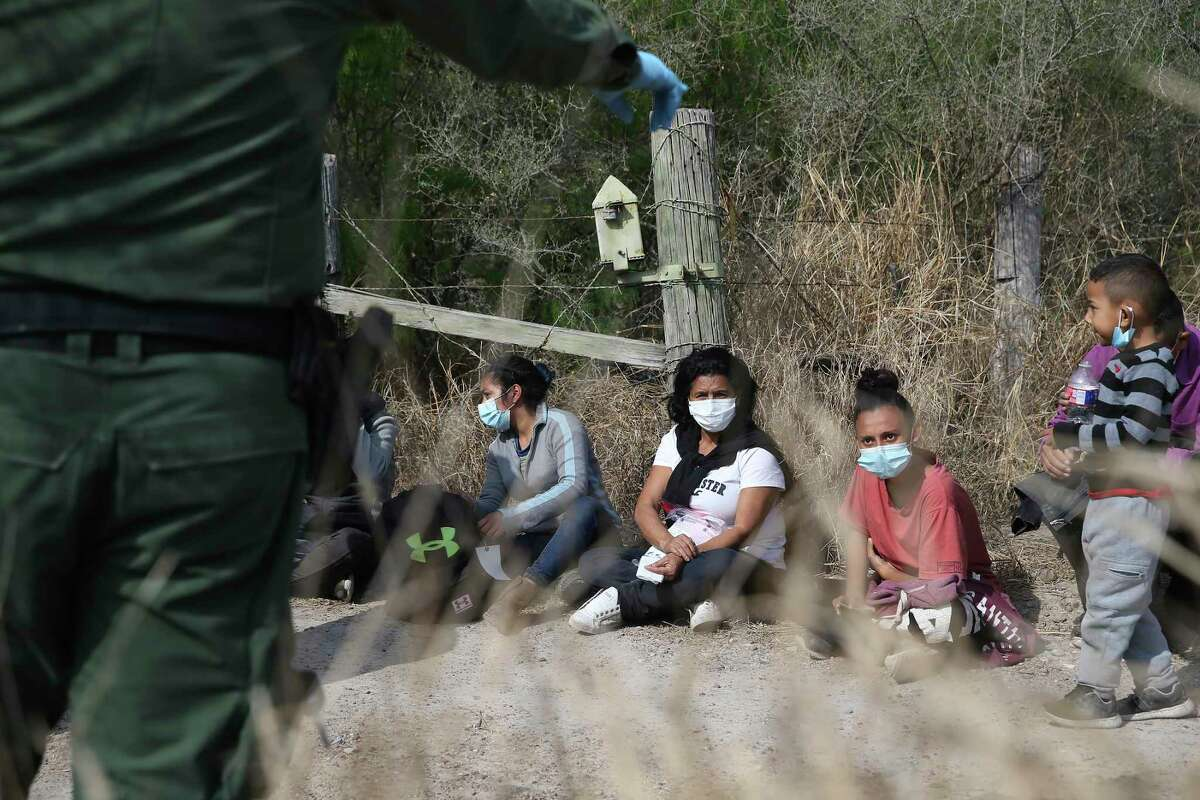 Migrant families are detained by U.S. Border Patrol agents by La Joya, Texas, Friday, March 26, 2021. The group consisted of mostly Central American migrants. In the afternoon, a group 17 Republican U.S. Senators visited the area for a tour of the Rio Grande by Anzalduas Park in Mission.