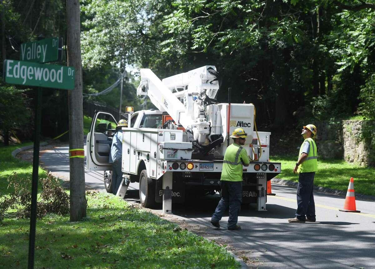 Crews repair downed trees and power lines one week from when Tropical Storm Isaias hit Greenwich, Conn. Tuesday, Aug. 11, 2020.