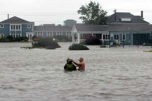 Steve and Nanci (CQ) Errante of Branford swim together in front of the Pine Orchard Country Club in Branford after the worst of Hurricane Irene passed through the shoreline of Connecticut. August 28,2011