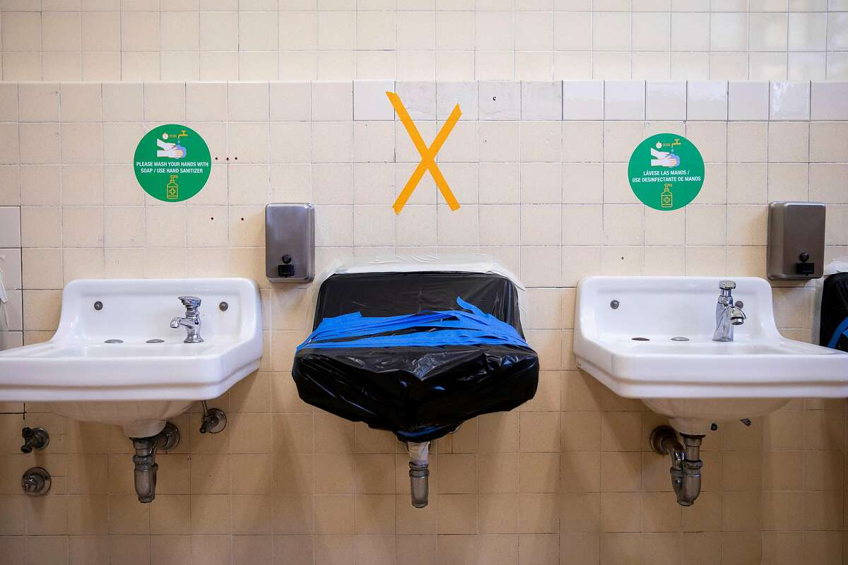 Every other bathroom sink is taped up to promote social distancing at Garfield Elementary School in Oakland.