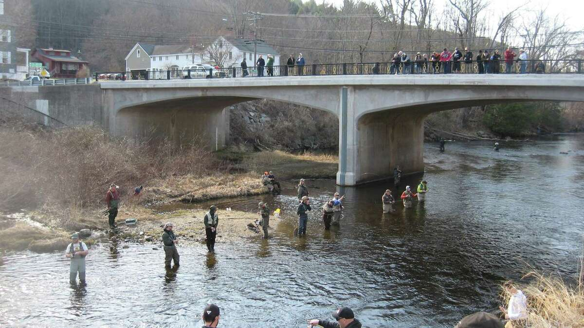 Anglers cast lines in the Farmington River near the former Hitchcock Chair Factory during the Riverton Fishing Derby in 2018. The 71st Riverton Fishing Derby will be held April 10.