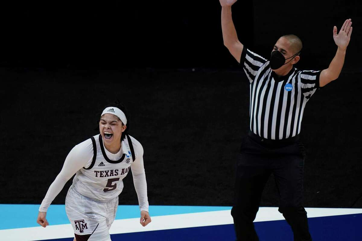 Texas A&M guard Jordan Nixon celebrates after making a 3-point basket during overtime of a college basketball game against Iowa State in the second round of the NCAA women's tournament at the Alamodome in San Antonio, Wednesday, March 24, 2021. (AP Photo/Eric Gay)