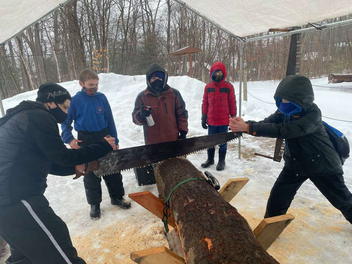 Members of Torrington Troop 3, Cub Scouts and Boy Scouts, spent a day in February chopping wood and hauling logs at Camp Workcoeman.