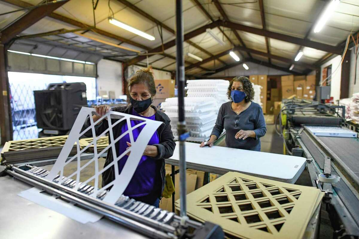 Margie Aguilar completes a filter Thursday at Filters4Air. With people concerned about air quality, owner David Dilling expects revenue to double this year, though business slowed at the start of the pandemic.