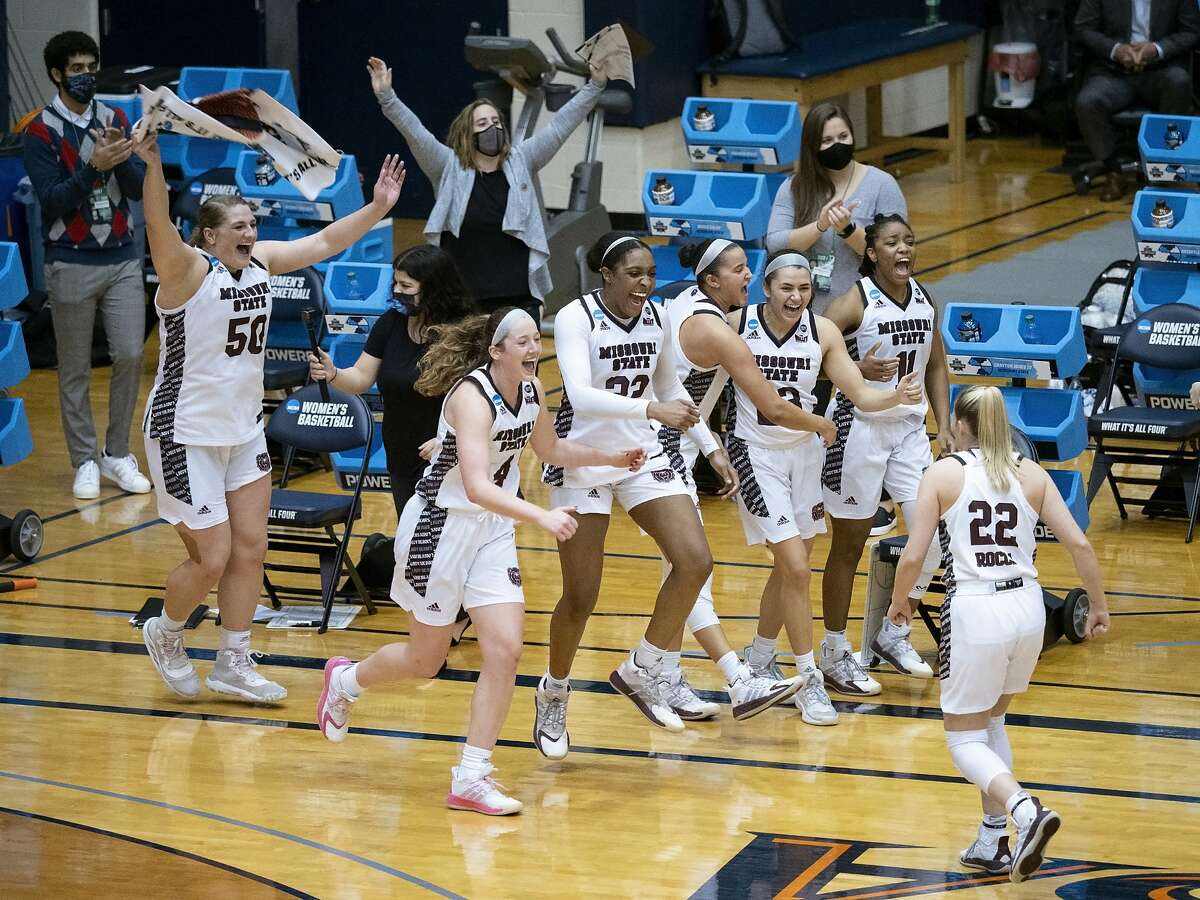 Missouri State players celebrate a win over Wright State in the second round of the NCAA women's tournament at the UTSA Convocation Center in San Antonio, Wednesday, March 24, 2021. Missouri State won 64-39. (AP Photo/Michael Thomas)
