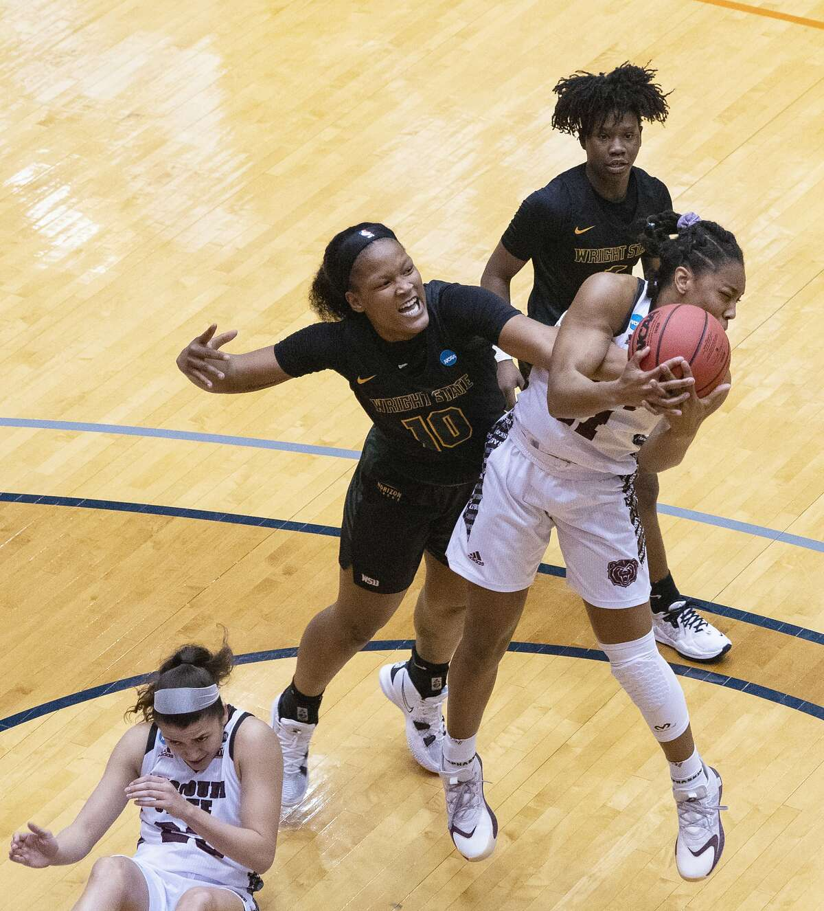 Missouri State guard Brice Calip, right, fights for a rebound with Wright State Forward Shamarre Hale during the second quarter of a college basketball game in the second round of the women's NCAA tournament at the University of Texas at San Antonio Convocation Center in San Antonio, Texas, Wednesday, March 24, 2021. (AP Photo/Michael Thomas)