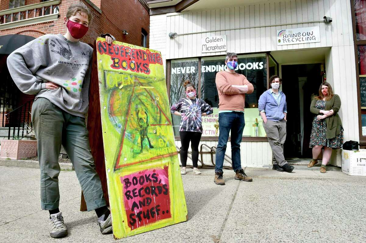 Jessica Larkin-Wells of New Haven, Jordanna Packtor of New Haven, Conor Perreault of New Haven, Peter Cunningham of Hamden and Jules Bakes of Hamden, from left, are fans of the community-minded Never Ending Books in New Haven.