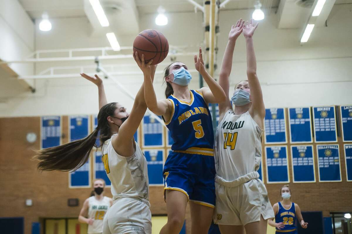 Midland's Olivia Carpenter takes a shot during the Chemics' district final loss to Dow Friday, March 26, 2021 at Midland High School. (Katy Kildee/kkildee@mdn.net)
