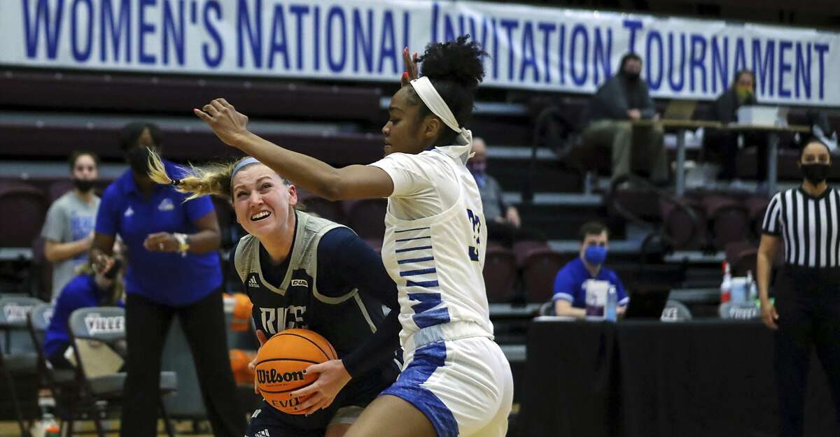 Rice forward Lauren Schwartz drives against Delaware forward Ty Battle (32) during an NCAA college basketball game in the semifinals of the WNIT in Collierville, Tenn., Friday, March 26, 2021. (Patrick Lantrip/Daily Memphian via AP)