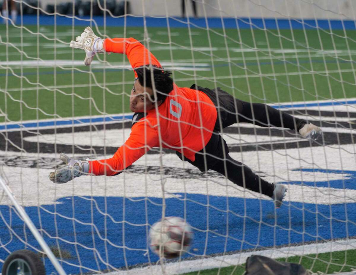 Midland High goalie Manuel Varela dives but can't reach the ball as its makes it in the corner of the net on an overtime penalty kick against El Paso Pebble Hills 03/26/21 during the Class 6A bi-district playoff game at Grande Communications Stadium. Tim Fischer/Reporter-Telegram