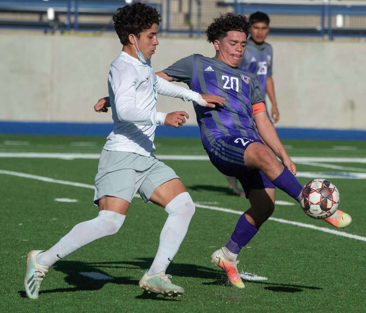 Midland High's Israel Ramirez battle for the ball with El Paso Pebble Hills' Felix Casas 03/26/21 during the Class 6A bi-district playoff game at Grande Communications Stadium. Tim Fischer/Reporter-Telegram