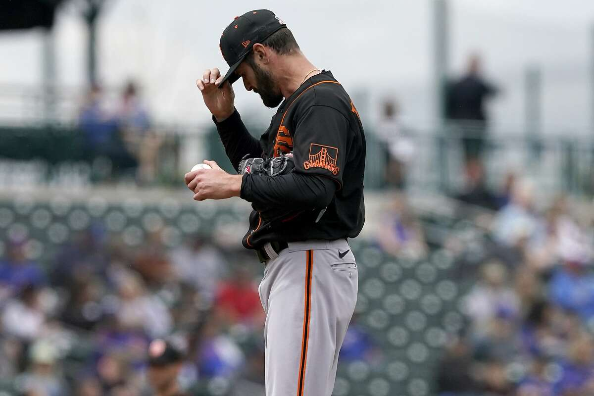 San Francisco Giants starting pitcher Nick Tropeano adjusts his cap after giving up a home run against the Chicago Cubs during the first inning of a spring training baseball game, Friday, March 26, 2021, in Mesa, Ariz. (AP Photo/Matt York)