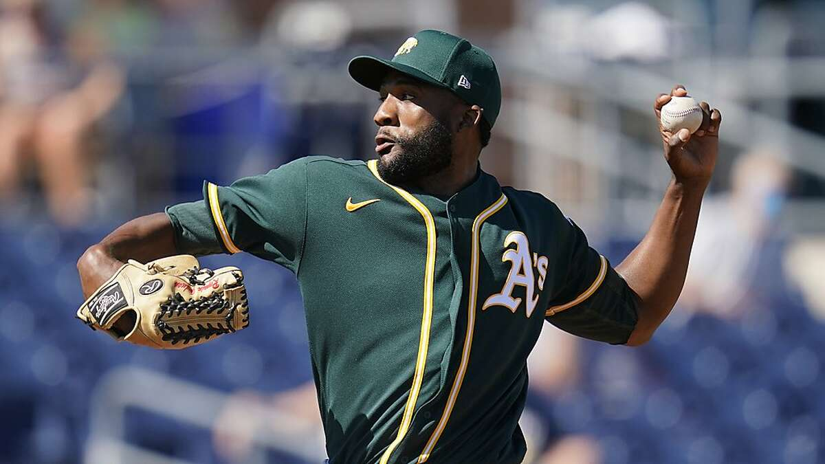 Athletics' Reymin Guduan pitches during a spring game against the Mariners on March 6.