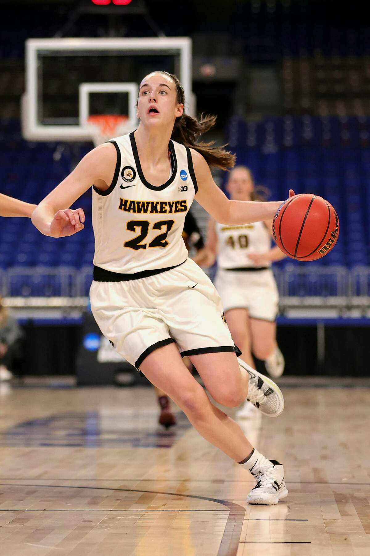 Iowa's Caitlin Clark controls the ball during first-round action in the NCAA Tournament at the Alamodome on March 21, 2021, in San Antonio, Texas. (Carmen Mandato/Getty Images/TNS)