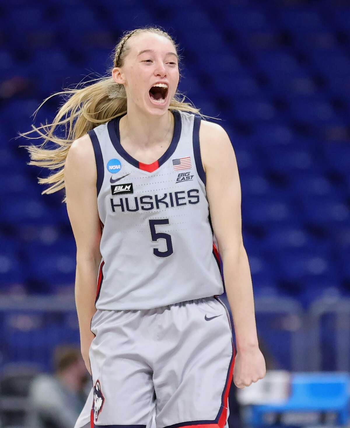 SAN ANTONIO, TEXAS - MARCH 23: Paige Bueckers #5 of the UConn Huskies reacts against the Syracuse Orange during the second half in the second round game of the 2021 NCAA Women's Basketball Tournament at the Alamodome on March 23, 2021 in San Antonio, Texas. (Photo by Carmen Mandato/Getty Images)