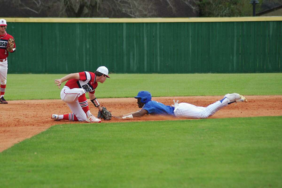 Dawson's Connor Lee, shown making the tag here, pitched 4 1/3 innings and struck out 10 while collecting two hits in helping lead the Eagles to a District 23-6A win Friday night.