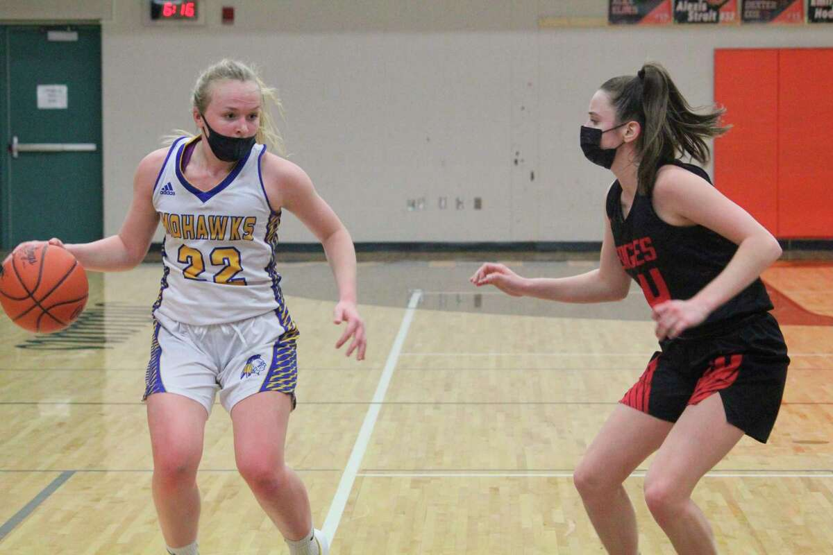 Morley Stanwood's Madison Garbow (22) goes against Kent City's Taryn Preston in Friday's district title game at White Cloud. (Pioneer photo/John Raffel)
