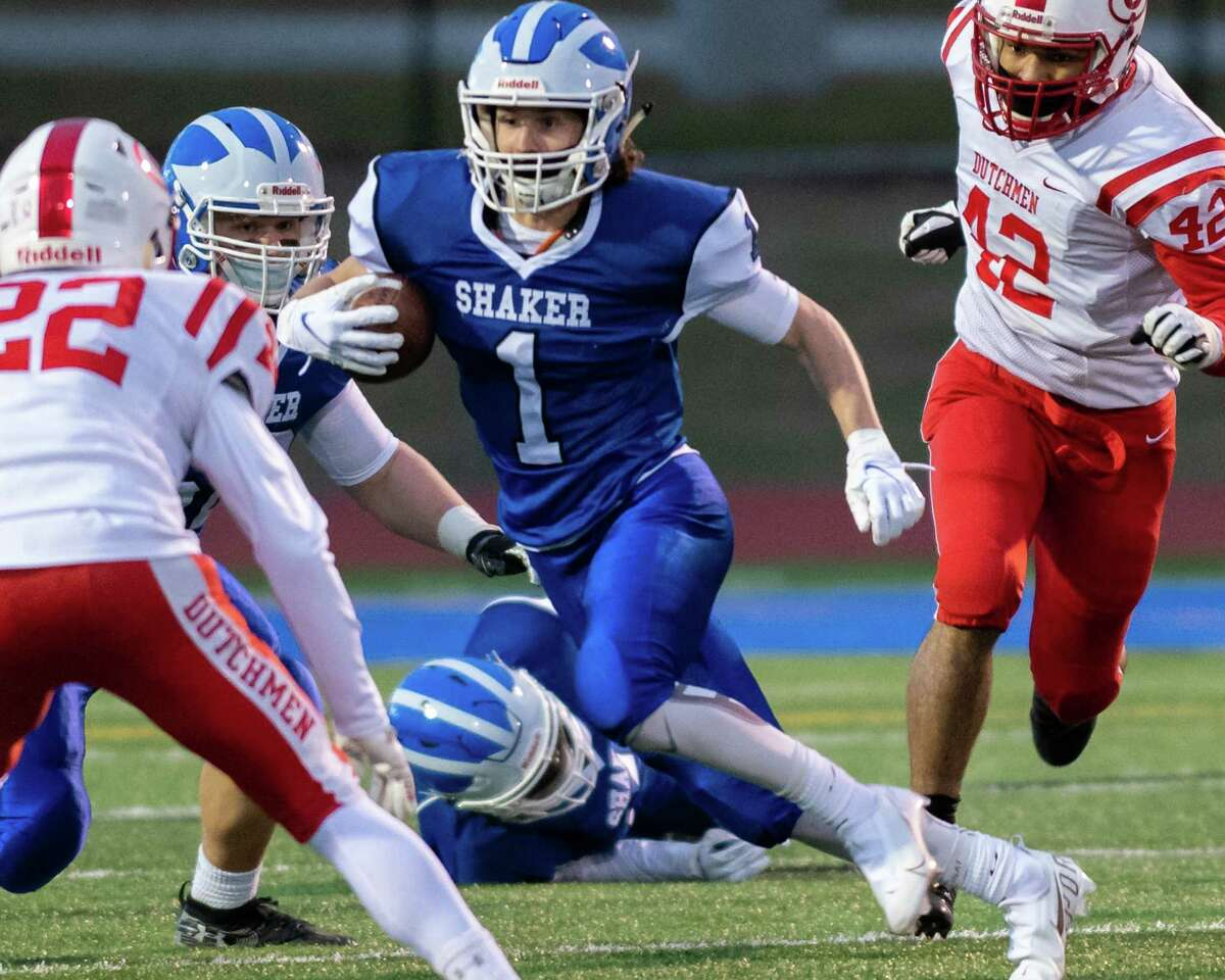 The senior running back carried the ball five times for 79 yards and two touchdowns to go along with a 30-yard touchdown reception, helping power the Blue Bison past Guilderland 35-25. Here, Strand looks for room against Guilderland during the Suburban Council matchup.