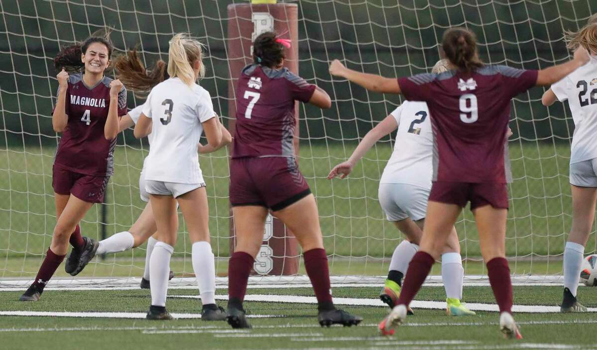 Magnolia's Danika Etter (4) celebrates after her goal broke a 1-1 tie during the second period of a bi-district high school soccer match, Friday, March 26, 2021, in Waller.