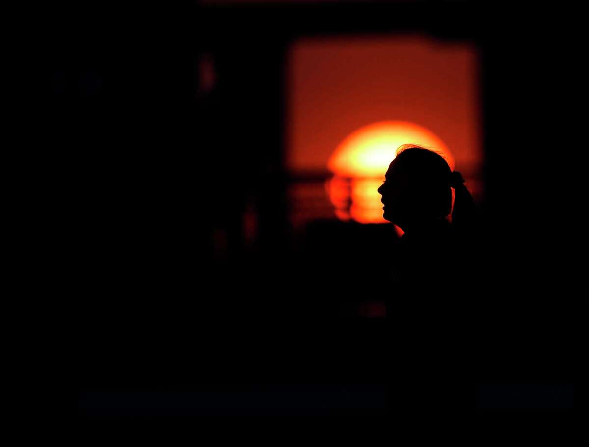 The sun sets during the second period of a bi-district high school soccer match between Lake Creek and Magnolia, Friday, March 26, 2021, in Waller.
