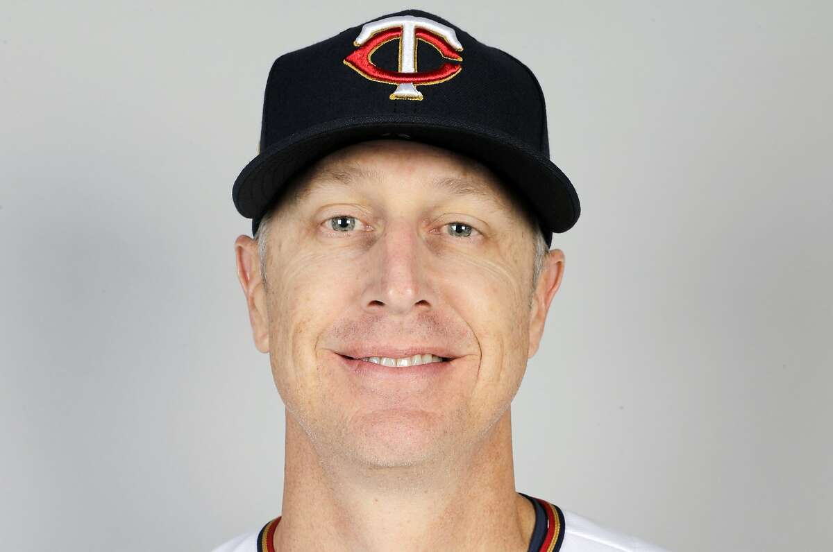 FILE - This is a 2020 file photo showing Mike Bell of the Minnesota Twins baseball team. Bell has died of kidney cancer. He was 46. He was the younger brother of Cincinnati Reds manager David Bell. (AP Photo/Brynn Anderson, File)