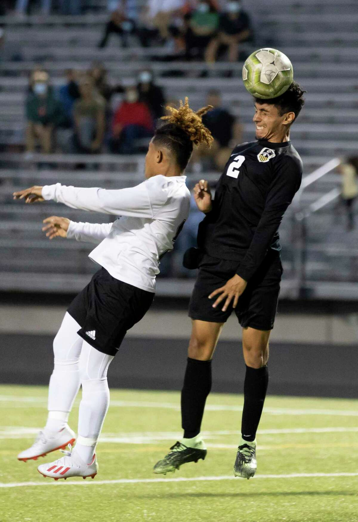 Conroe Carlos Salinas (2) and Eisenhower Hector Zavala (2) jump to head butt the ball during the first half of a a Region II-6A bi-district boys soccer playoff game at Moorhead Stadium, Friday, March 26, 2021, in Conroe.