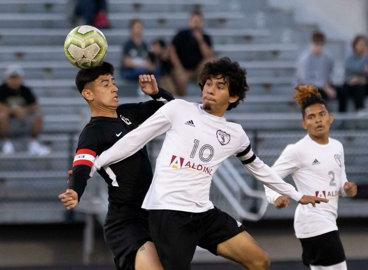 Eisenhower Anderson Amaya Martinez (10) and Conroe Daniel Ruiz (10) collide while fighting for control of the ball during the first half of a a Region II-6A bi-district boys soccer playoff game at Moorhead Stadium, Friday, March 26, 2021, in Conroe.
