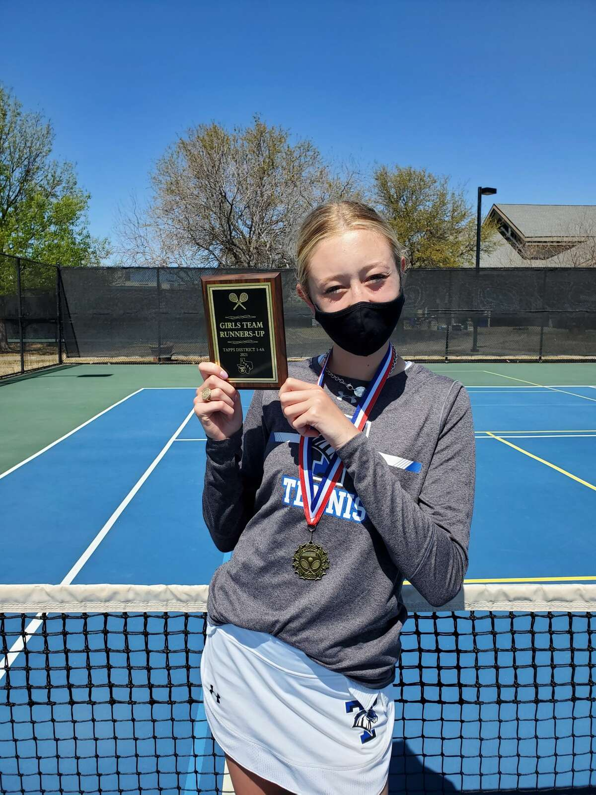 Trinity's Ellery Baker poses with her hardware after winning the girls singles title at the TAPPS 1-4A Tennis Tournament, March 26 in Arlington.