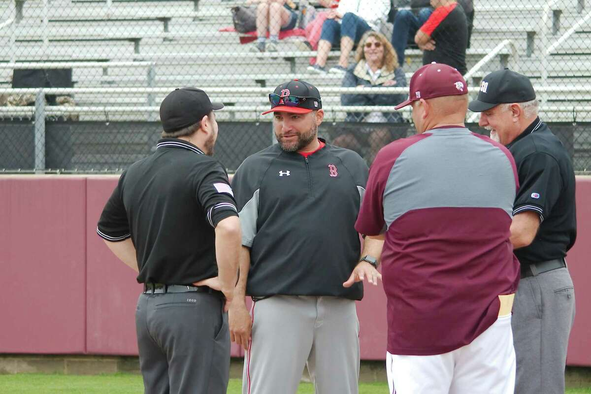 Clear Brook baseball coach Gene Flores (center) has watched his team surge to the top of the District 24-6A standings.