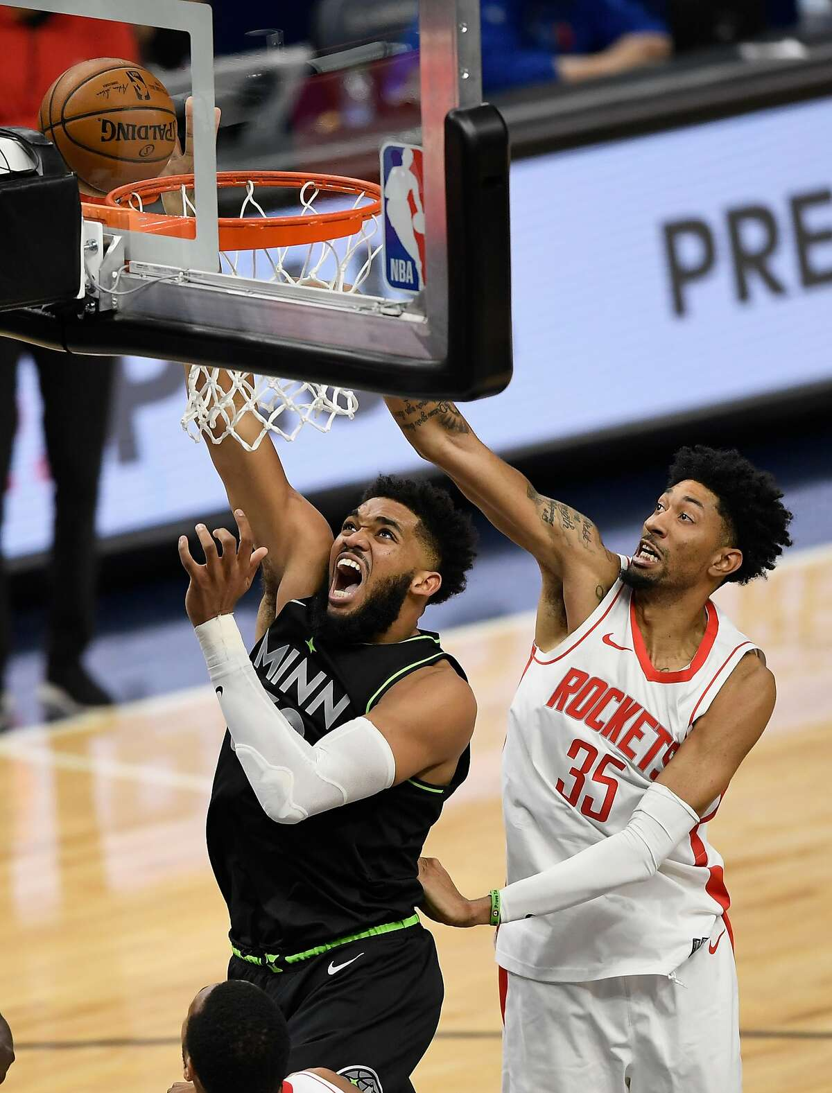 Karl-Anthony Towns, who scored 29 points, gets off a shot as the Rockets' Christian Wood defends.